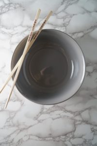 Empty Bowl with chopsticks for a Asian Chicken noodle soup bowl