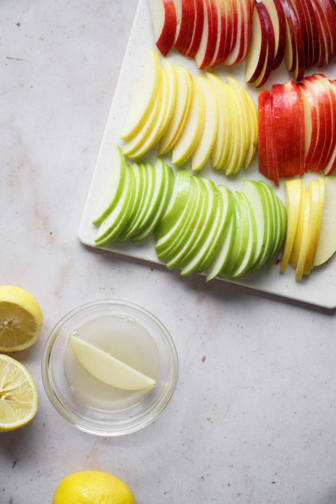 Sliced apple in lemon juice for apple and honey board for Rosh Hashanah