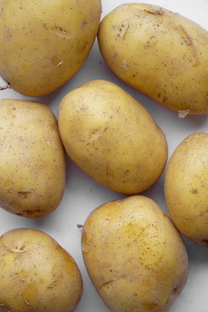 Close up of yukon gold potatoes for the best overnight potato kugel.